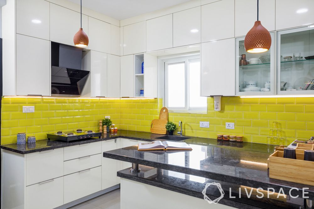interiors in hyderabad-subway tiles-yellow backsplash-high gloss laminate cabinets