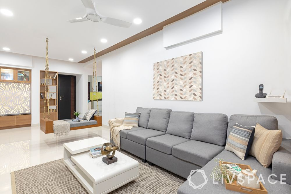 interiors in hyderabad-false ceiling-wooden laminate ceiling-L-shaped sofa-jhoola-tv unit