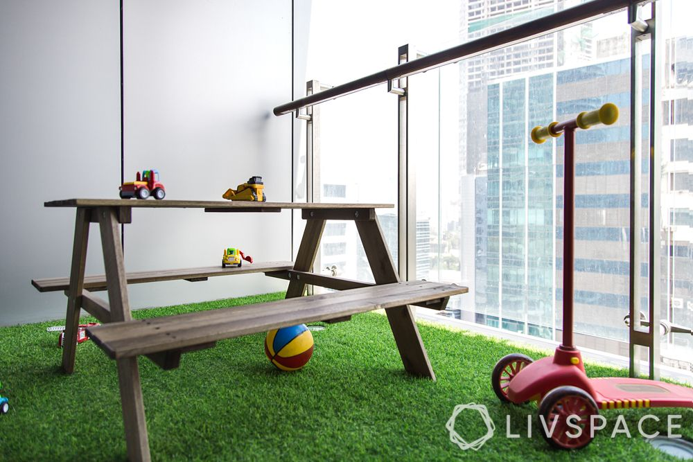 glass railing-park bench-toys-artificial turf