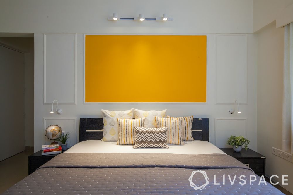 pop wall-white wall moulding-yellow patch on wall