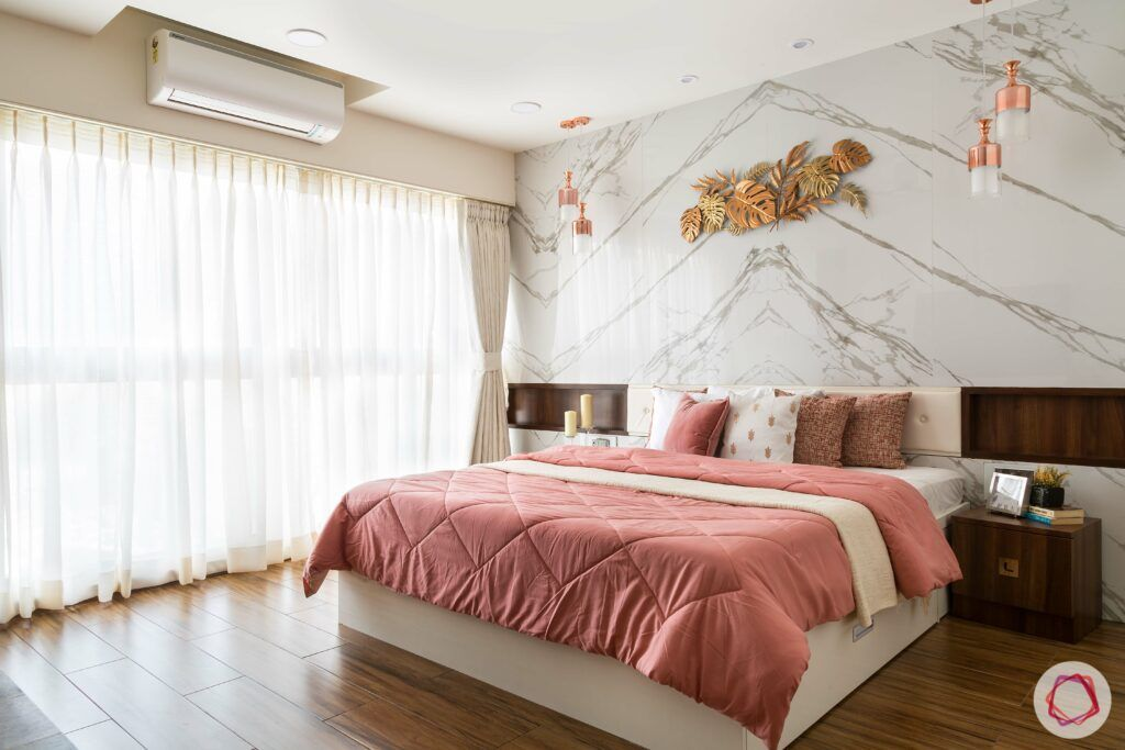 bedroom-interior-design-marble-wall-pink-sheets-gold-accent-wooden-floor
