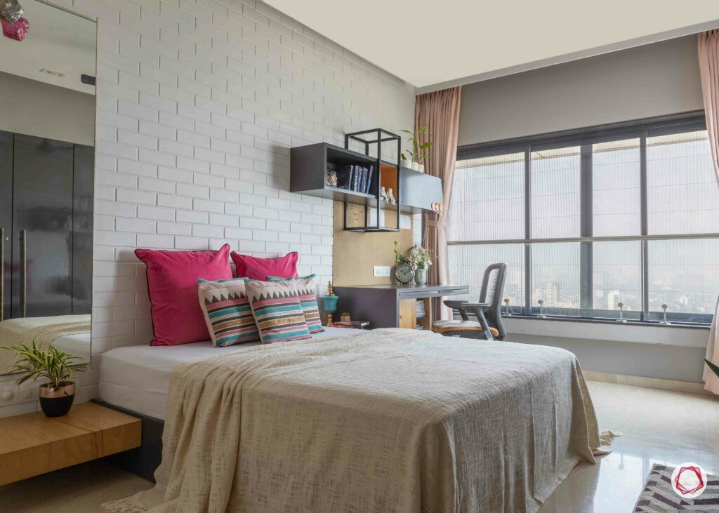 bedroom-interior-design-exposed-brick-wall-pink-pillow-study-table