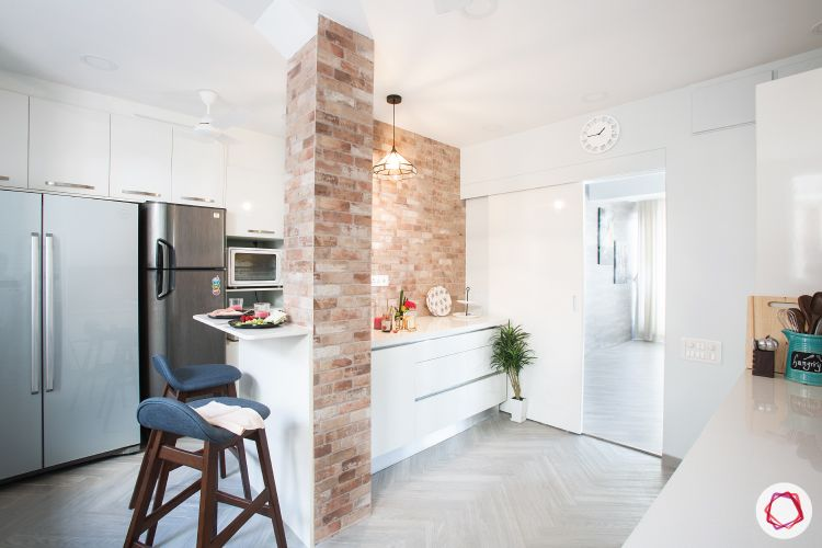 scandinavian interior design-exposed brick wall-tall units-white kitchen