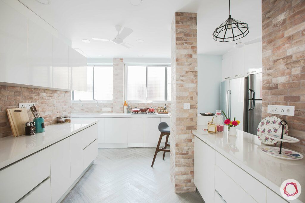 scandinavian interior design-white countertop-exposed brick wall