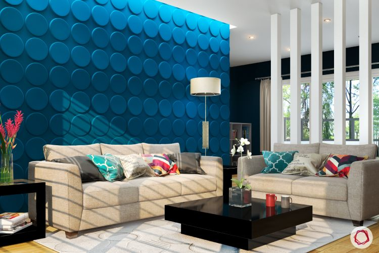 partition-chandelier-neutral sofa designs-blue cushions-wall art