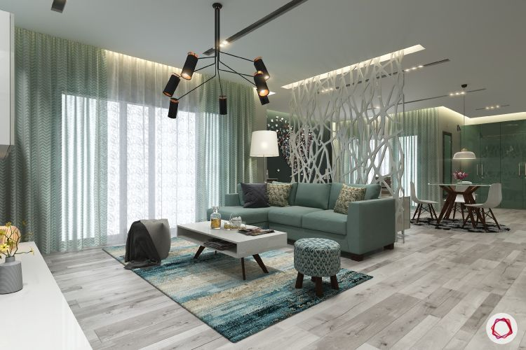 partition-green living room-green ottoman-green sofa-pendant lighting-lattice partition