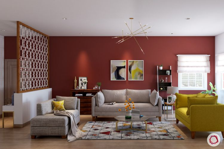 partition-red wall-yellow sofa-chandelier-carpet-neutral sofa designs