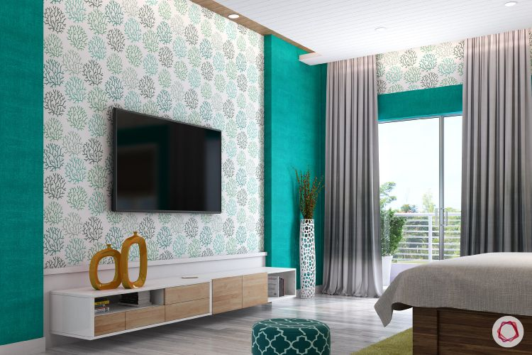 green wallpaper-white vase-tv unit-teal walls