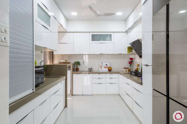 white cabinets-glossy cabinets-brown countertop-modular kitchen