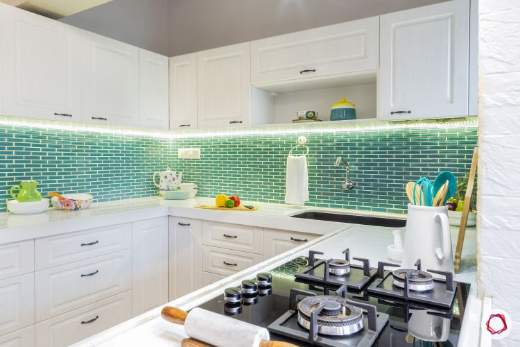 home lighting design-green backsplash designs-white cabinets-hob