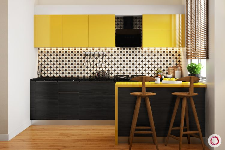 bright colours-yellow wall cabinets-black base cabinets-breakfast counter-wooden bar counter chairs-yellow breakfast counter