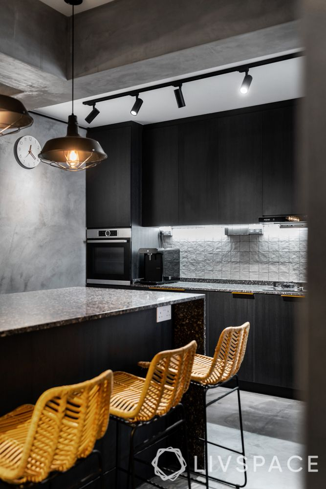 orange chairs-kitchen island-dining table-pendant lights-grey industrial design