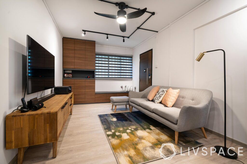 hdb interior design singapore-grey sofa-wooden cabinet-seating-blinds-wooden tv unit