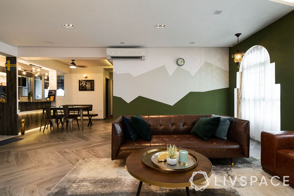 home renovation-brown sofa-green wall-dining room and kitchen