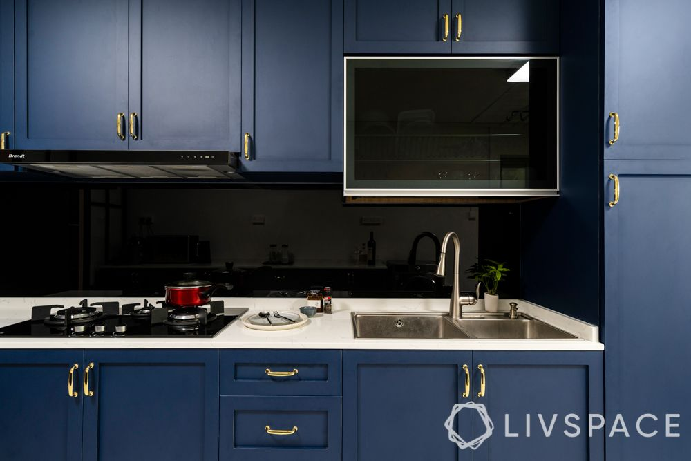 room decoration-fixtures-gold handles-ikea-blue cabinets