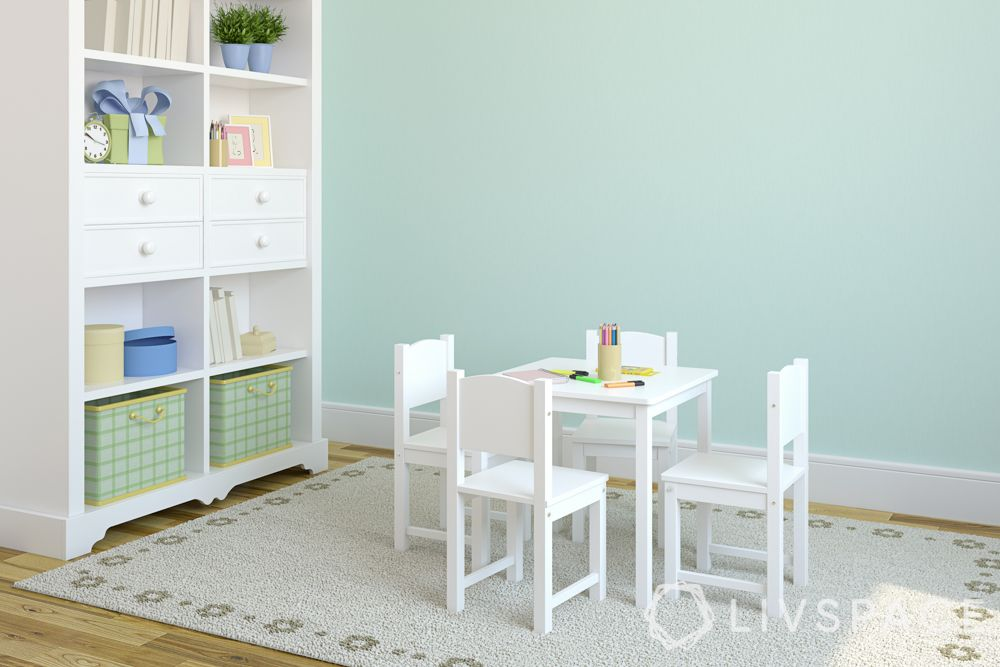 room colour ideas-green wall-white chairs-bookshelf-kids room