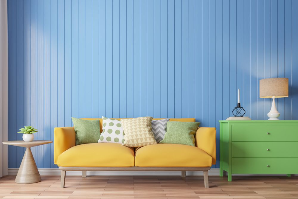 renovation in Singapore-green drawer-yellow sofa-blue walls