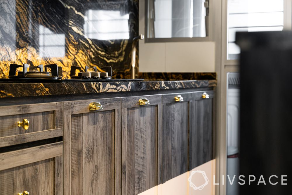 granite-black and gold-storage cabinets-gold knobs