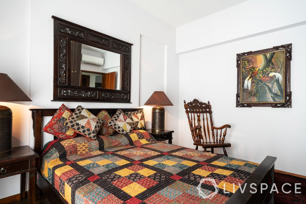 palm grove condo-bedroom-wooden mirror-painting-armchair