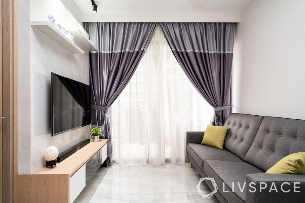 home design-living room-grey curtains-marble finish laminate-grey sofa-track lights